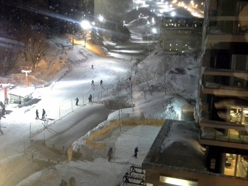 View of the slopes at night from the condo - Niseko