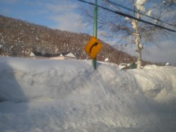 Niseko street sign buried under snow