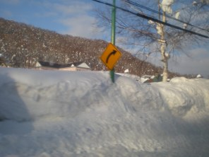 Niseko street sign buried under snow