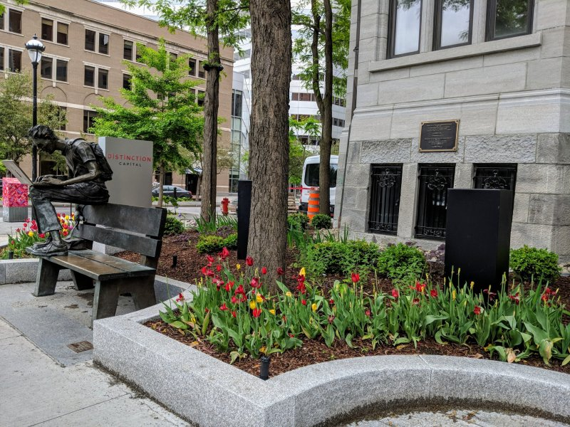The person in this statue is hunched over a laptop. Fitting for this day and age! Montreal